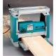 Cepillo eléctrico de regrueso Makita 304 mm 2.200 W 2012NB rebajando tablon